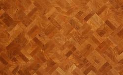 Bruk - niezwykle oryginalna i trwała podłoga drewniana. Widać na niej przekroje pnia